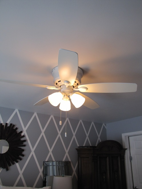 This is the master bedroom fan. The old one was yucky brown. with all the stuff going on around it white was best.